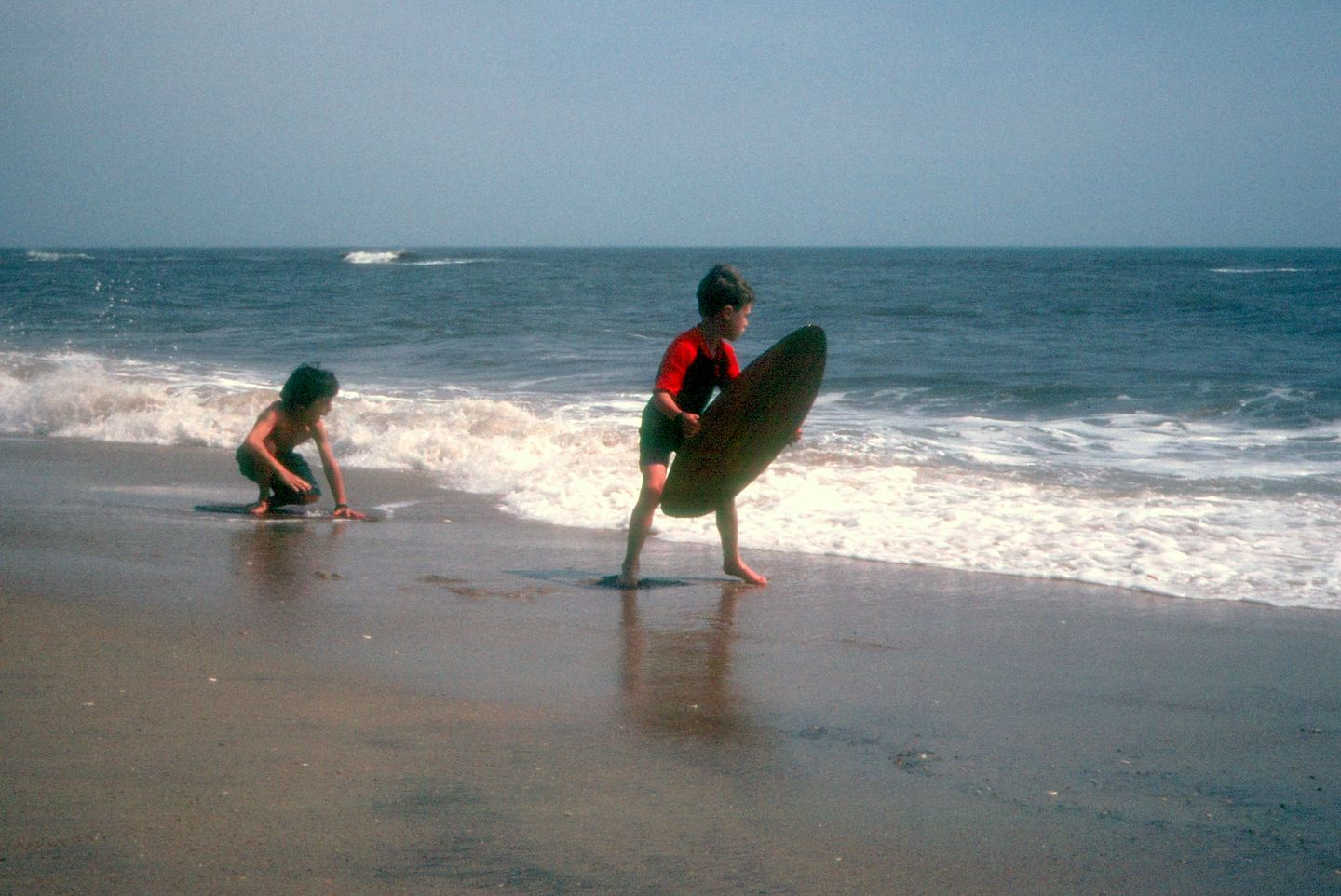 Determined skimboarders