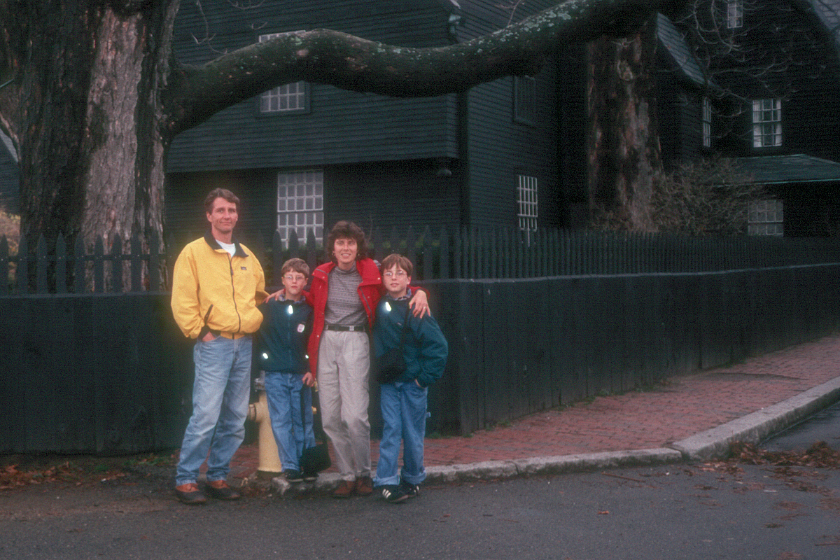 Family in front of House of 7 Gables