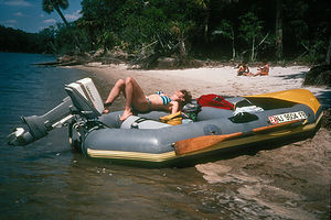Lolo reclining on raft in Hunting Island lagoon