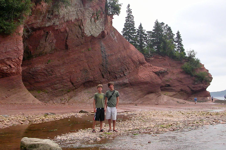 Boys exploring the sea caves