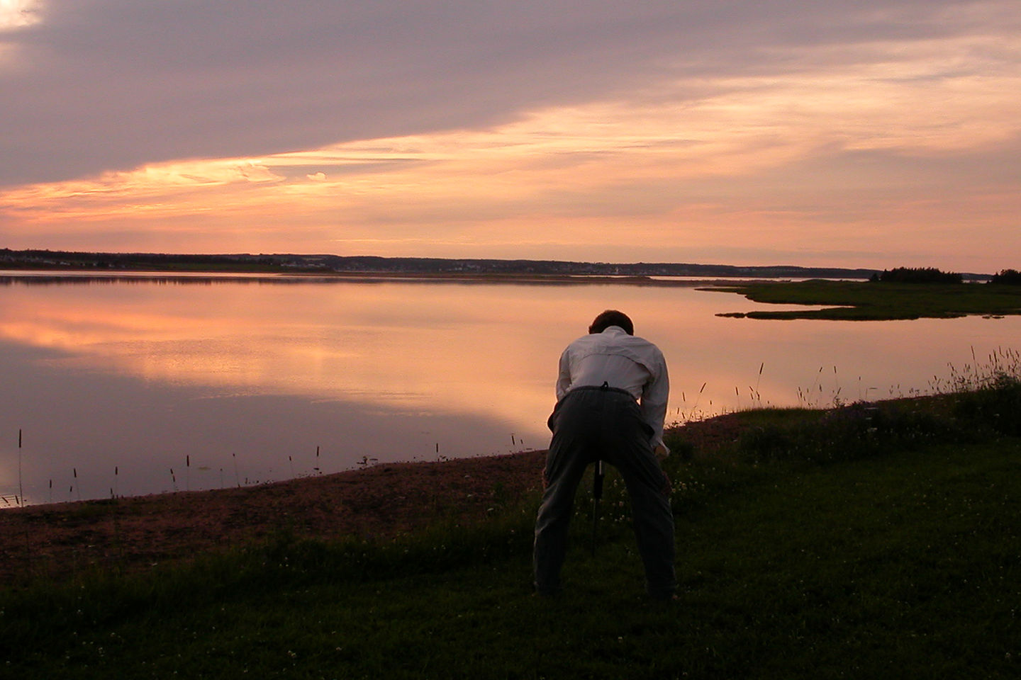 Herb photographing sunset from campsite