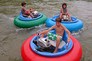 Lolo and boys in Bumper Boats