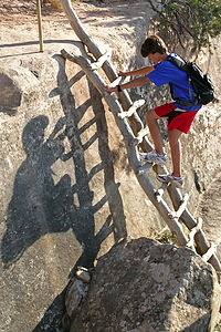 Tommy on the ladder to Sipapu Bridge