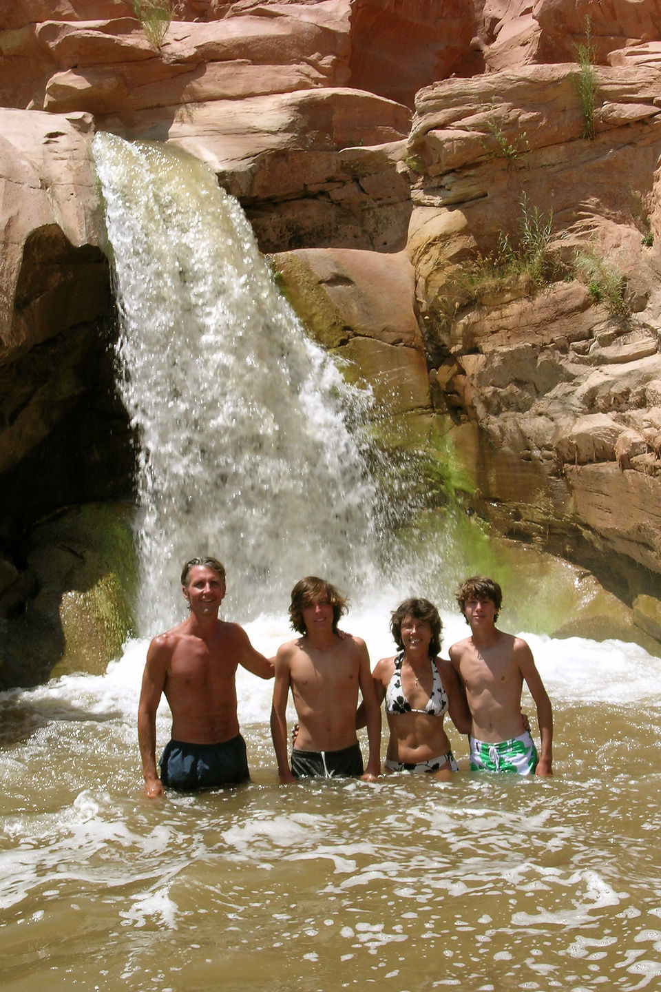Family at base of Capitol Reef waterfall