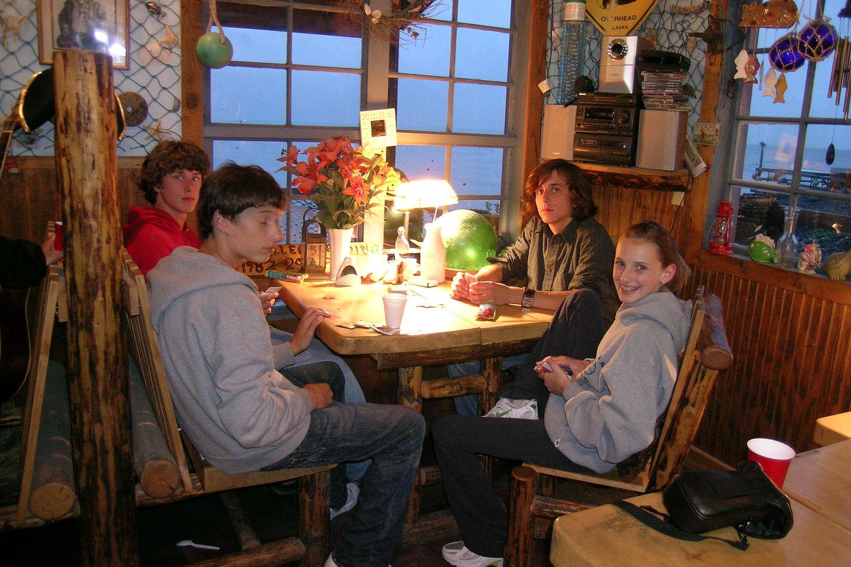 Kids playing cards in Miller's Landing lodge