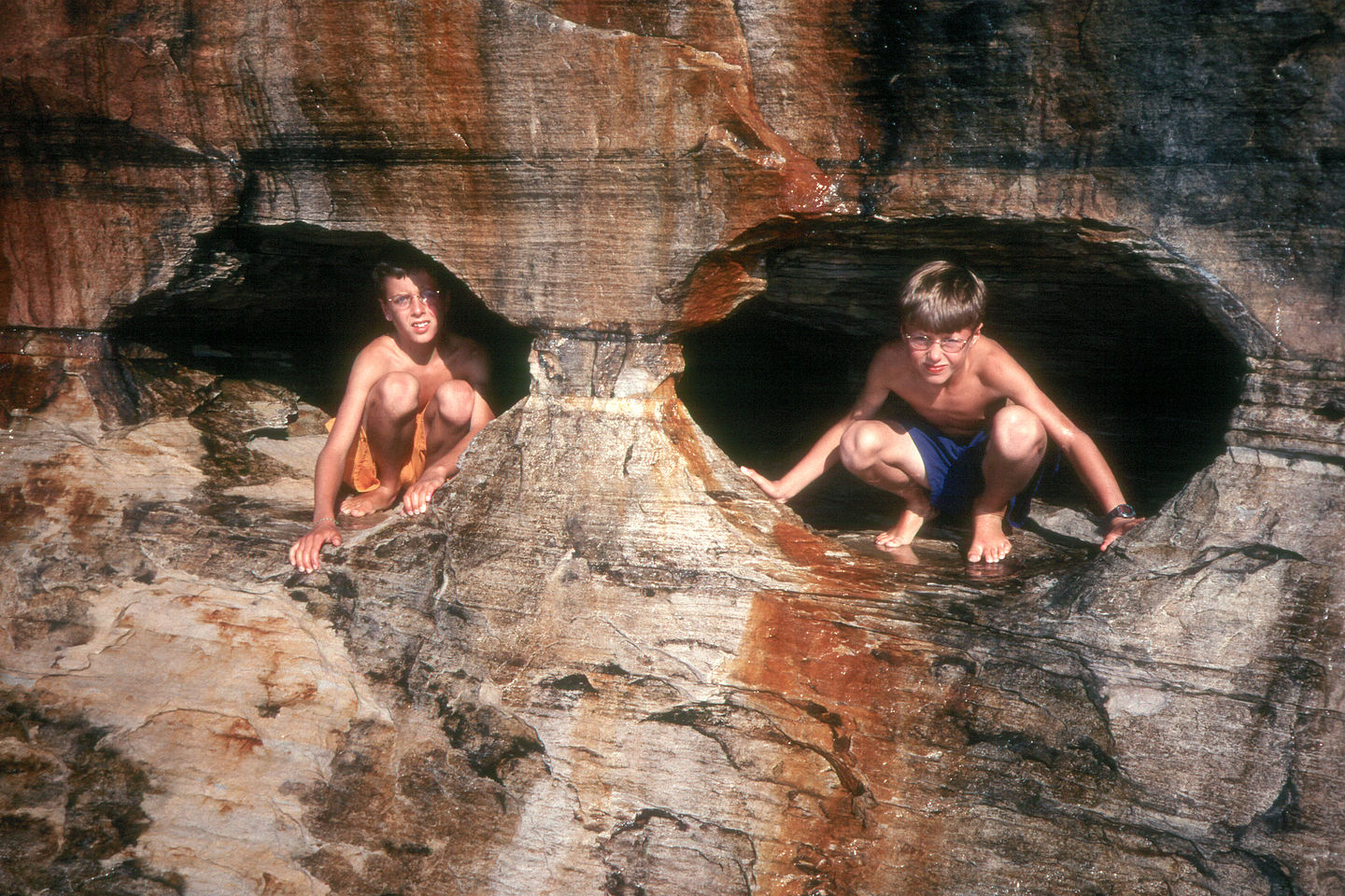 Boys in eyeglass sea caves