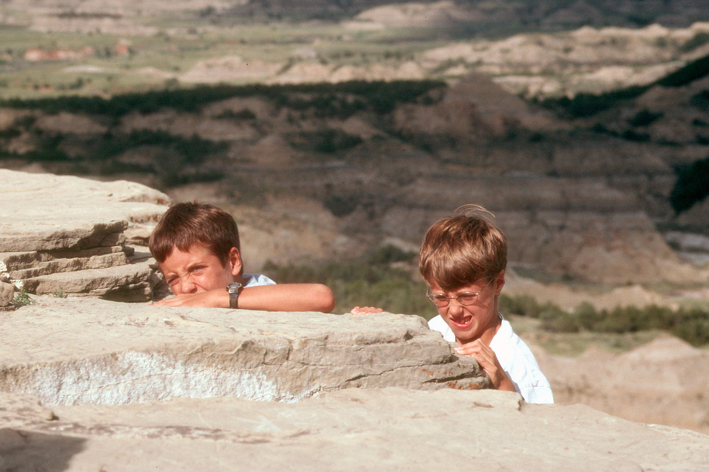 Boys climbing out of painted canyon