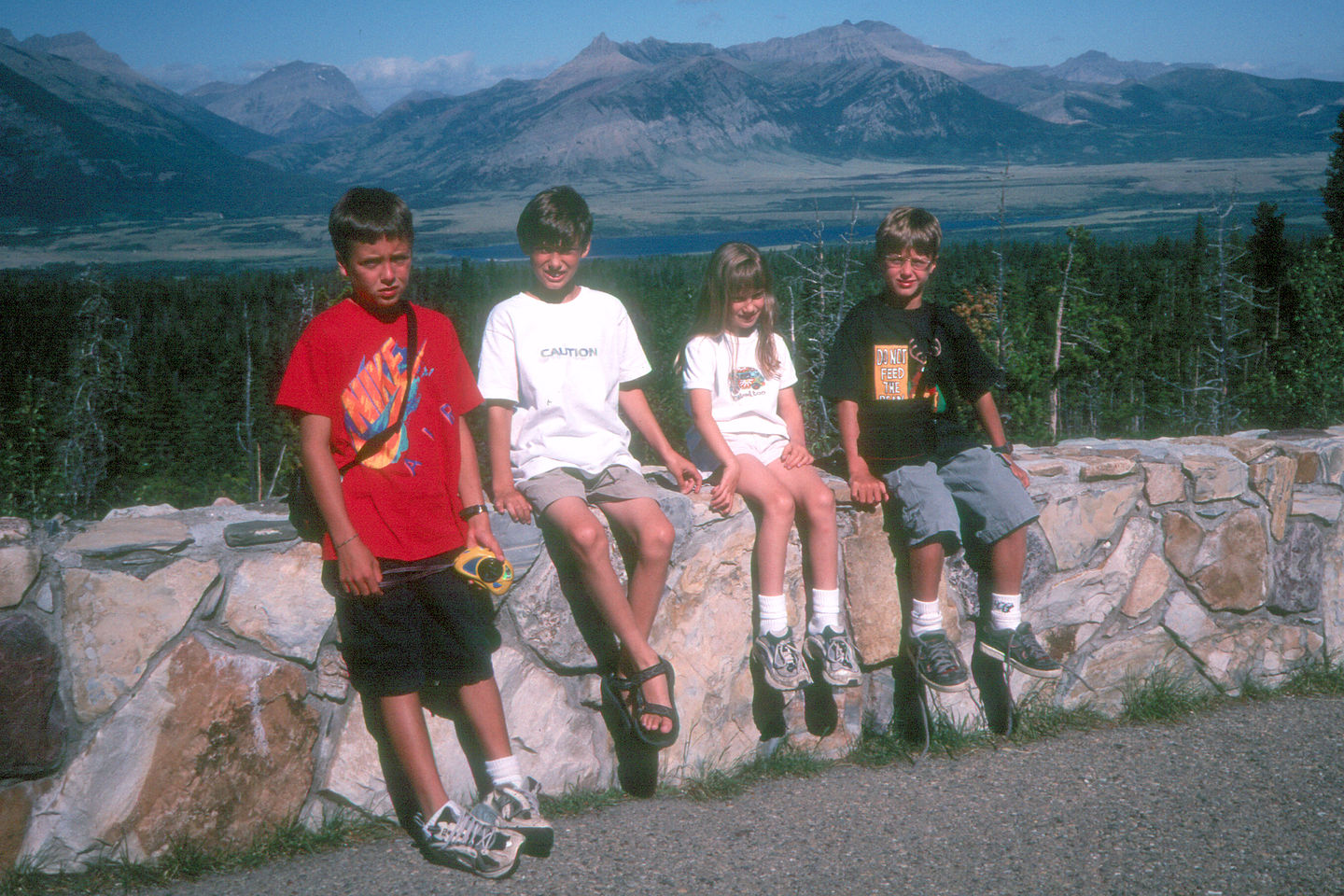 Kids on drive between Glacier and Waterton