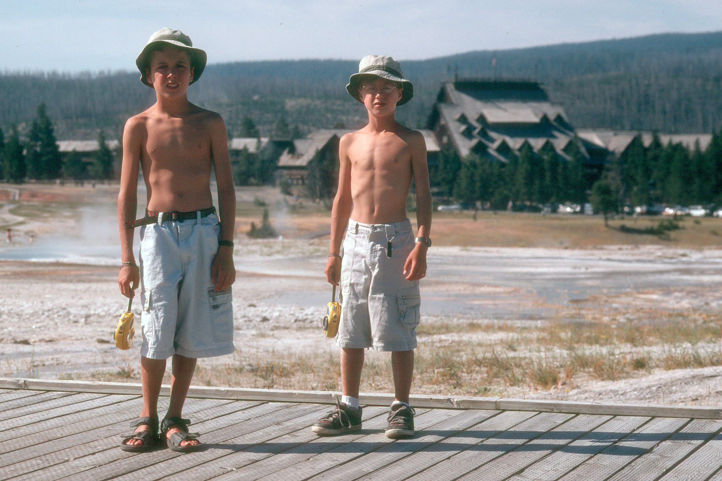 Boys on boardwalk by Old Faithful Inn