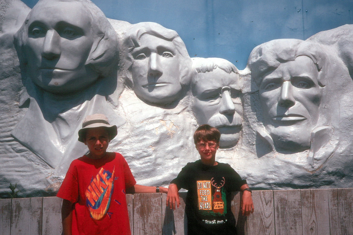 Boys in front of faux Mount Rushmore