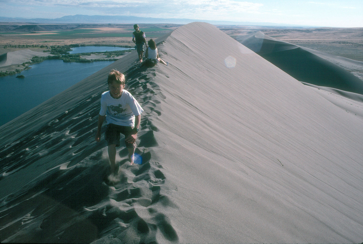 Lolo and boys on the knife edge of the dunes