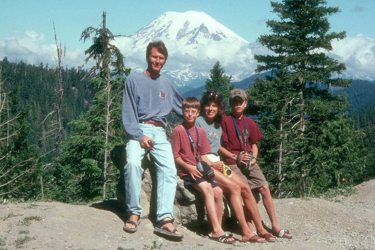 Family in front of the elusive Mt. Rainier