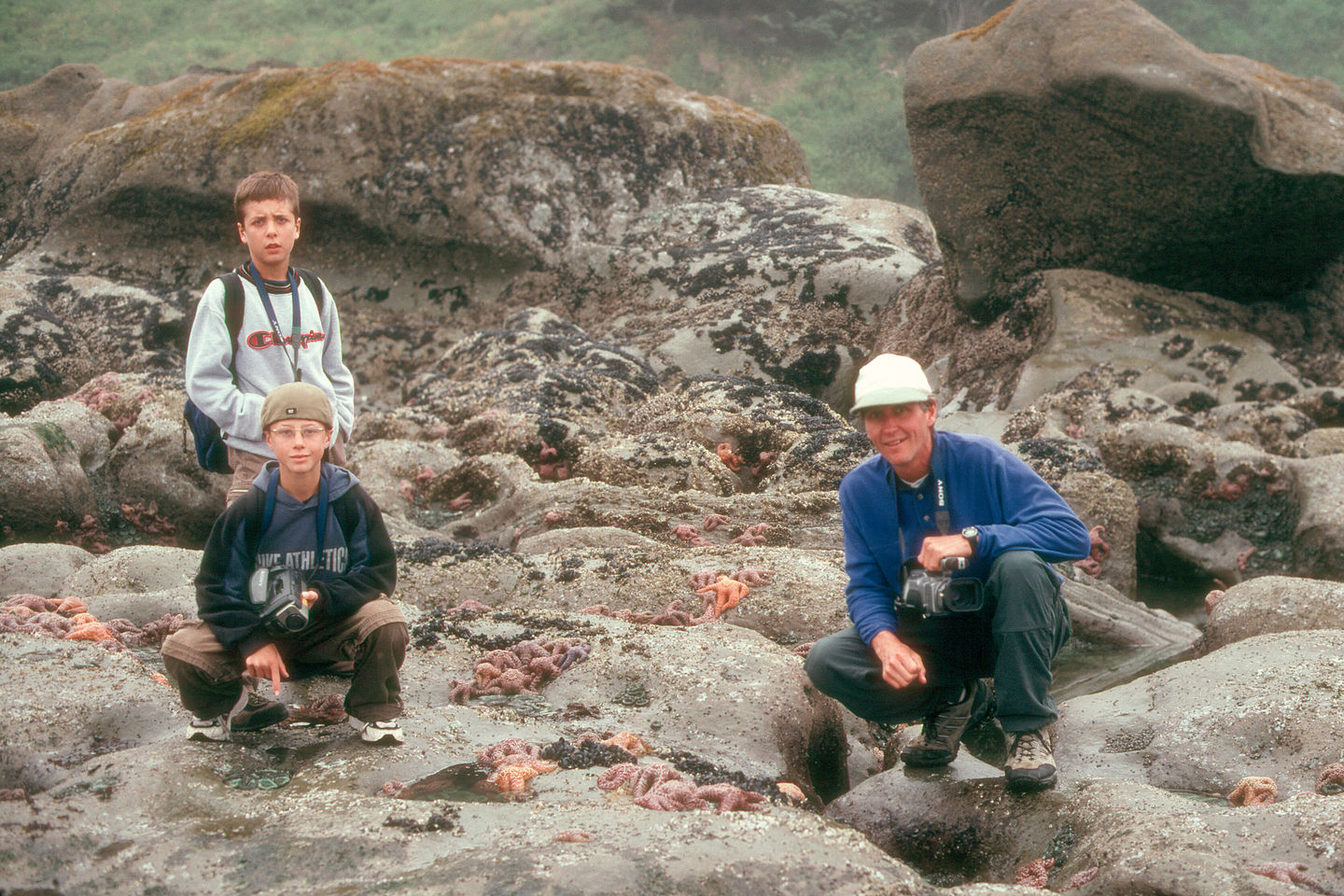 Herb and boys by tidal pools