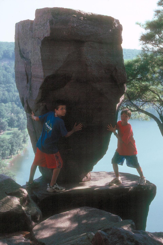 Boys holding up Balance Rock