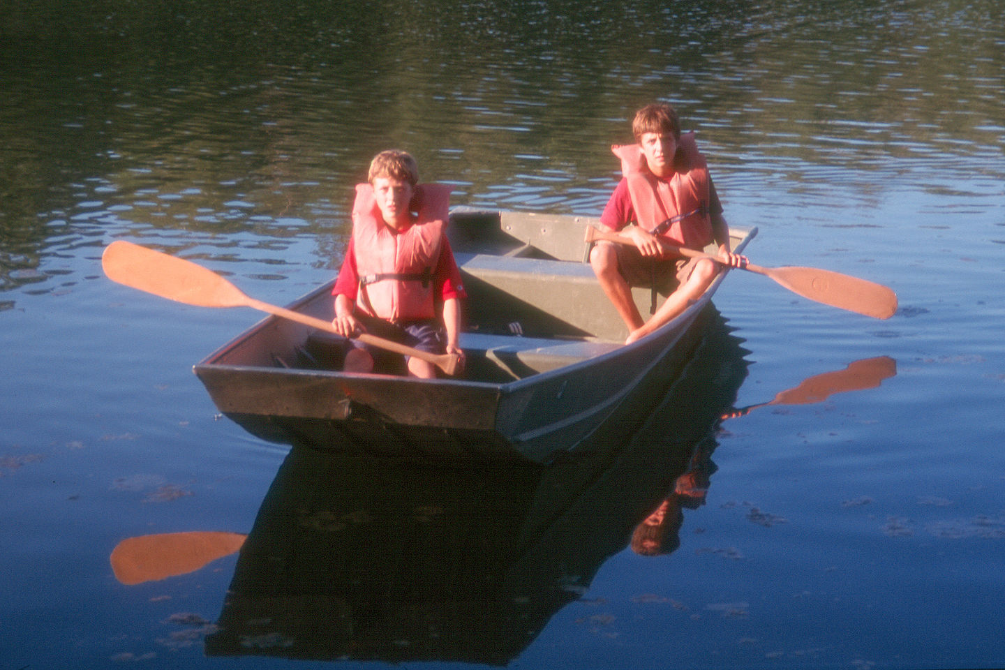 Boys rowing around Tishimingo Lake