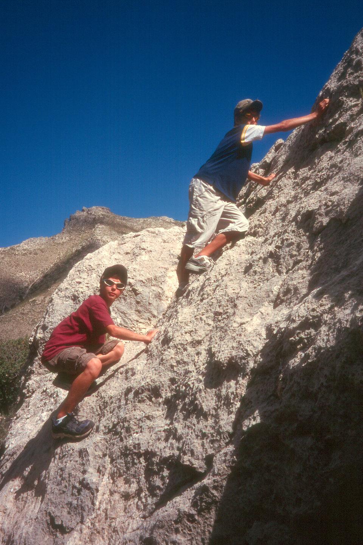 Boys rock scrambling on Devils Hall Trail
