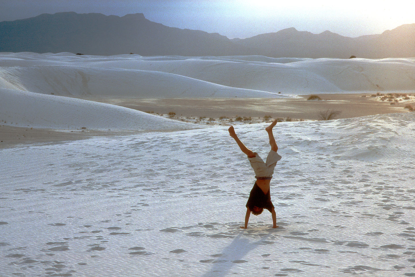 Andrew doing handstand on dunes
