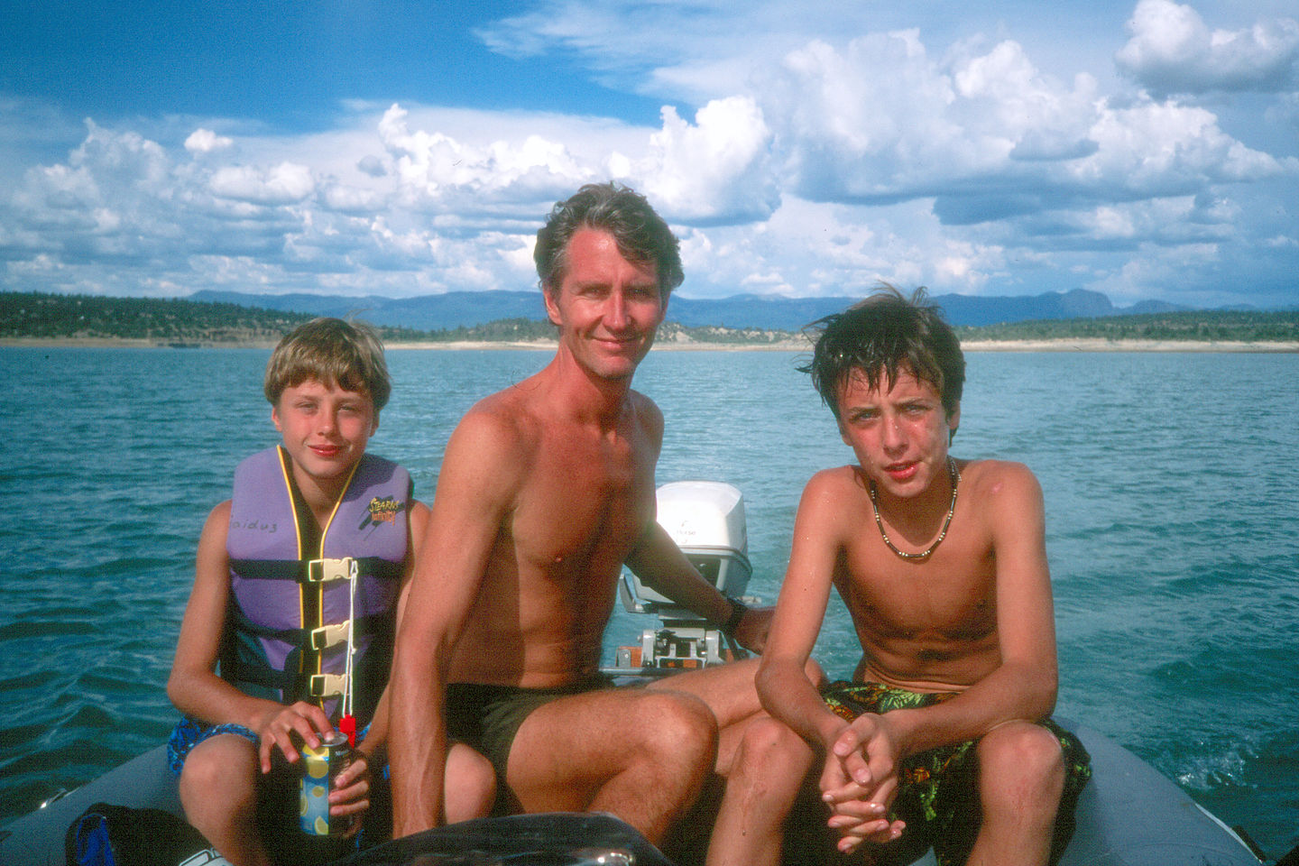 Herb and the boys on blowup boat in Heron Lake