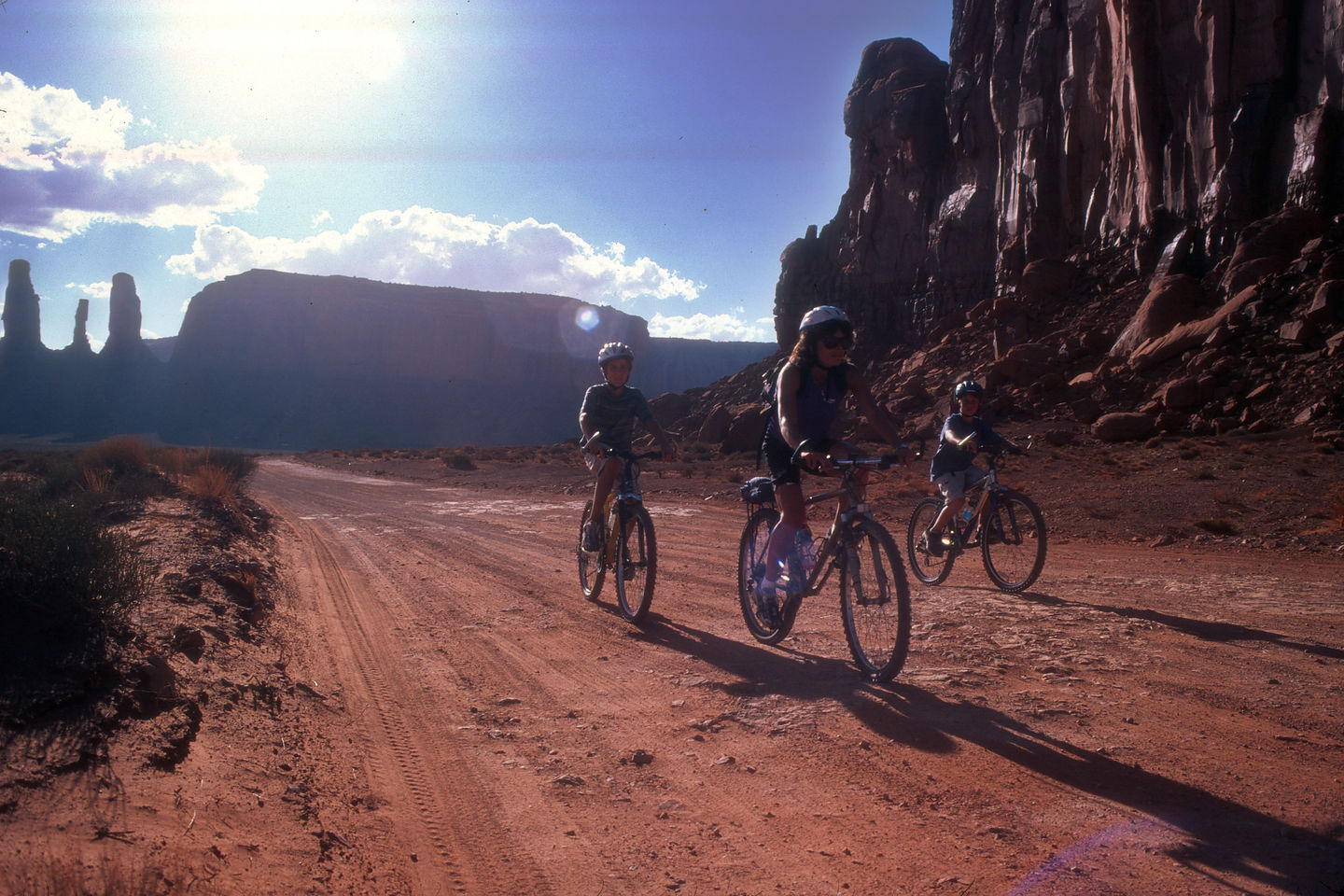 Lolo and the boys biking through Monument Valley