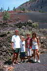 Family hiking through the lava flow