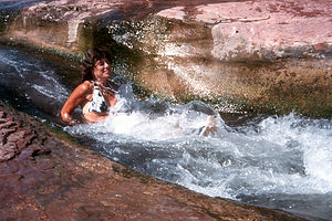Lolo sliding the slide rock gorge