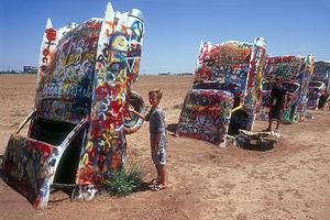 Boy's painting desert cadillacs