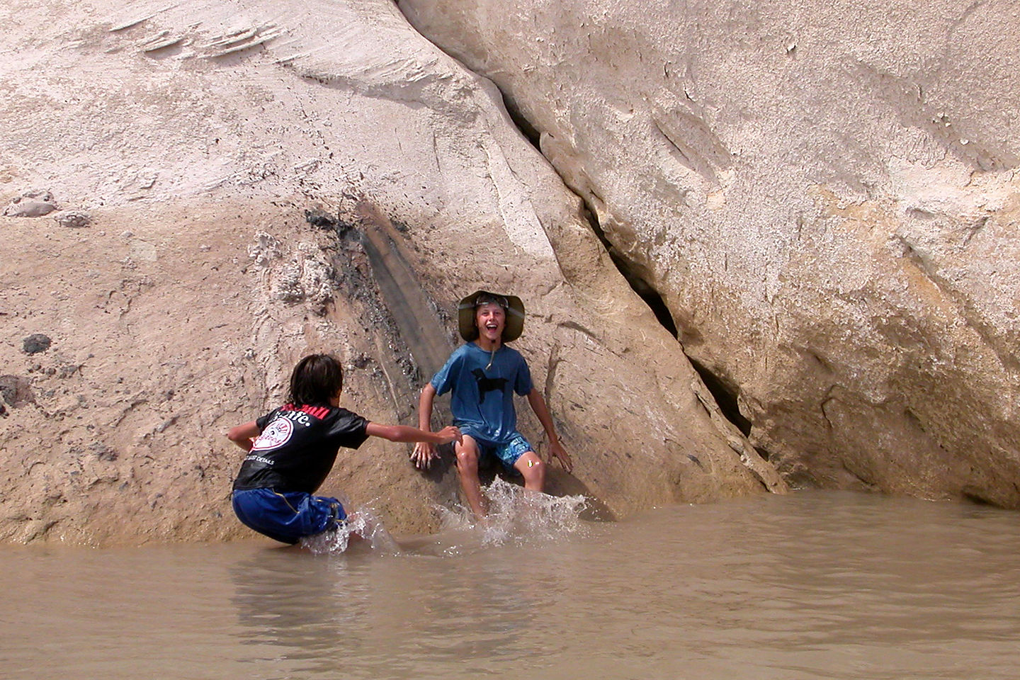 Boy's demonstrating use of the mudslide