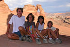 Windblown family reaches Delicate Arch