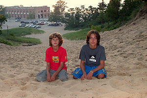 Boy's playing in the dunes overlooking the e.coli ridden lake