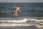 Boys goofing on boogie board