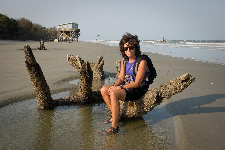 Lolo sitting on beach log