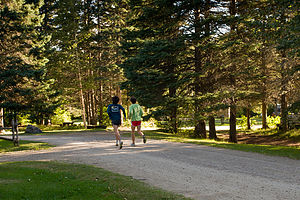 Boys running from Parc du Mont-Sainte-Anne Campground
