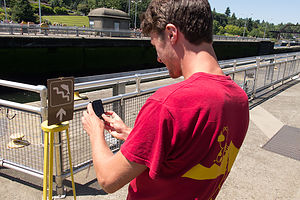 Tom Photographing Jumping Salmon Sign at Chittenden Locks