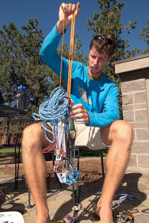 Tom organizing his climbing rack at the Crown Villa RV Resort