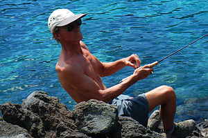 Herb catching a Trout at Fumarole Bay