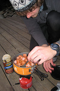 Nik cooking up some beans