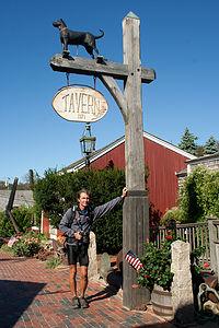 Herb holding up Black Dog Tavern Sign - LEG