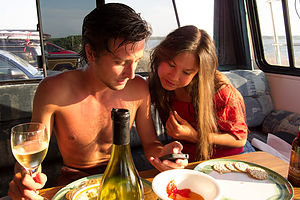 Andrew and Celeste dining in RV at State Beach