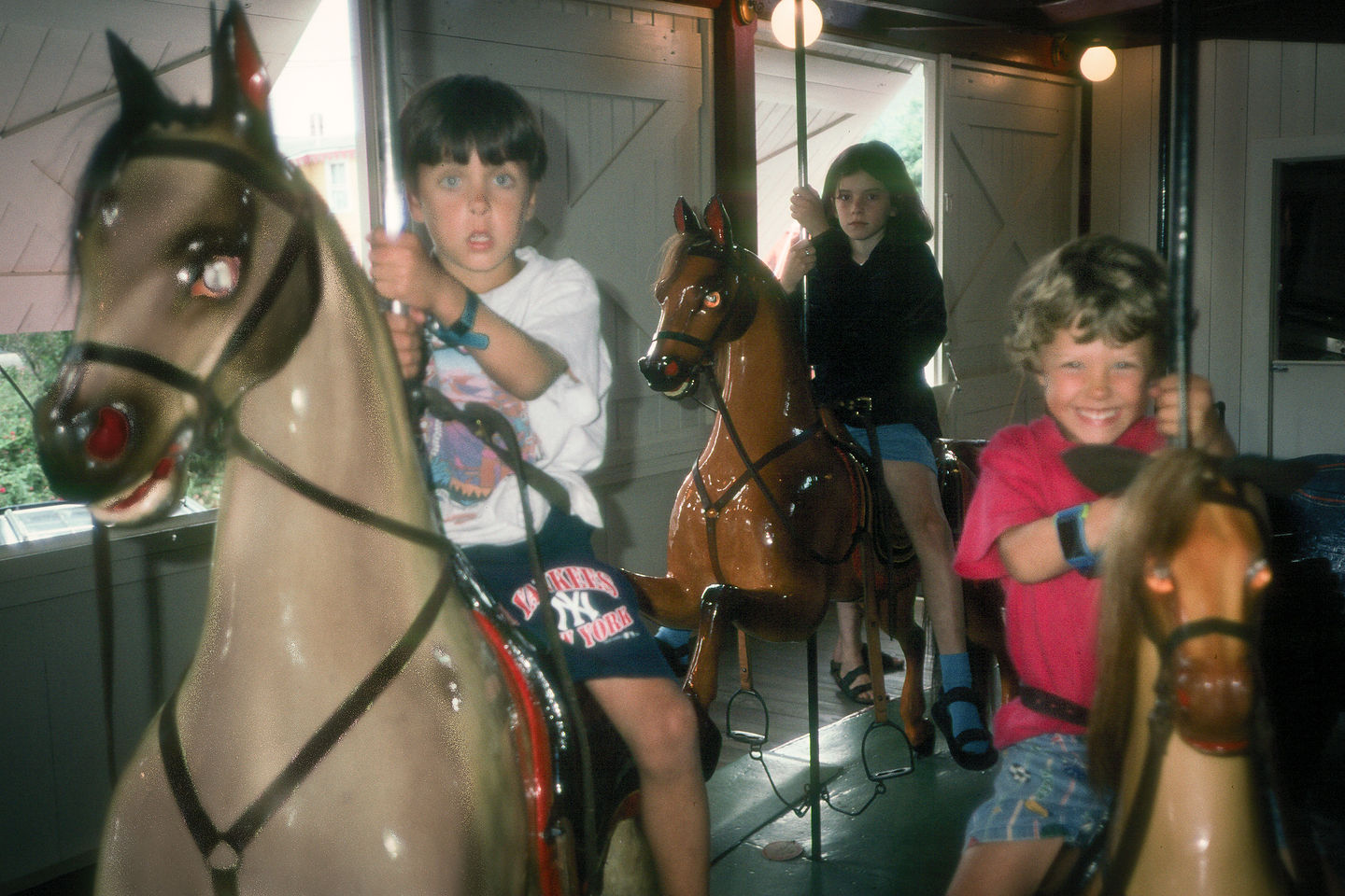 Andrew and Tommy riding Flying Horses Carousel