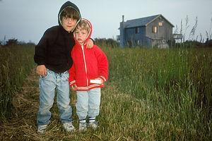 Boys on Farmland outside Tony's Rental House