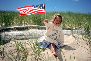 Madison waving US Flag at Chappy