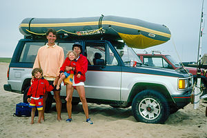 Family on beach with Isuzu Trooper and Avon Redshank