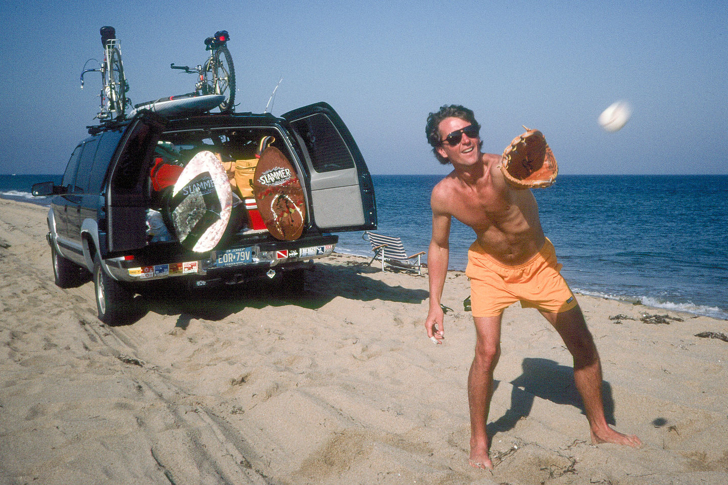 Herb playing catch on beach