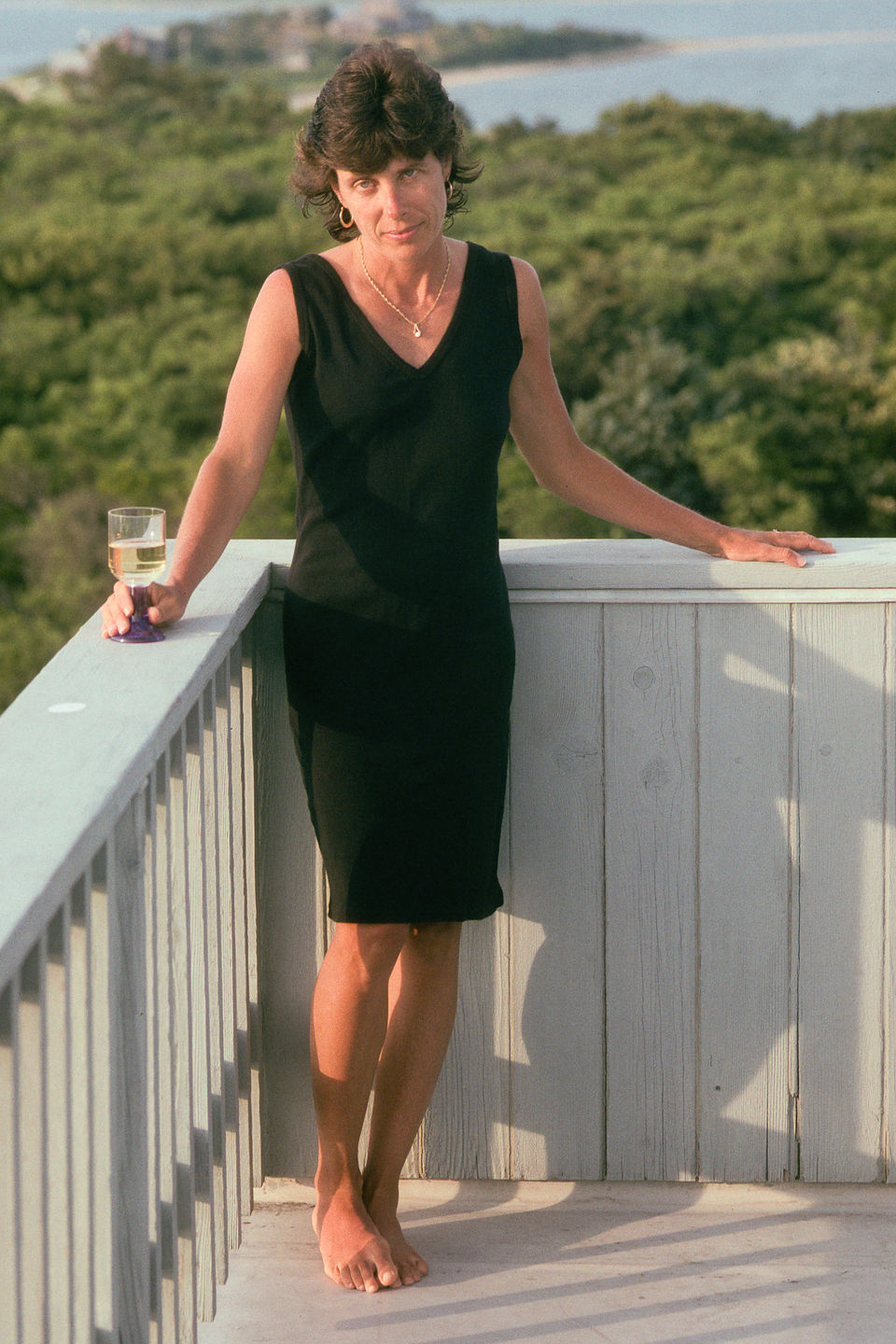 """Lolo in Black Dress on Deck of """"Gut House"""""""