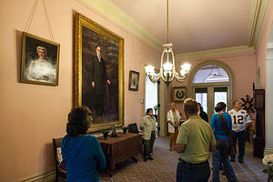 John and Annie Bidwell Portraits in Foyer with Tour Group