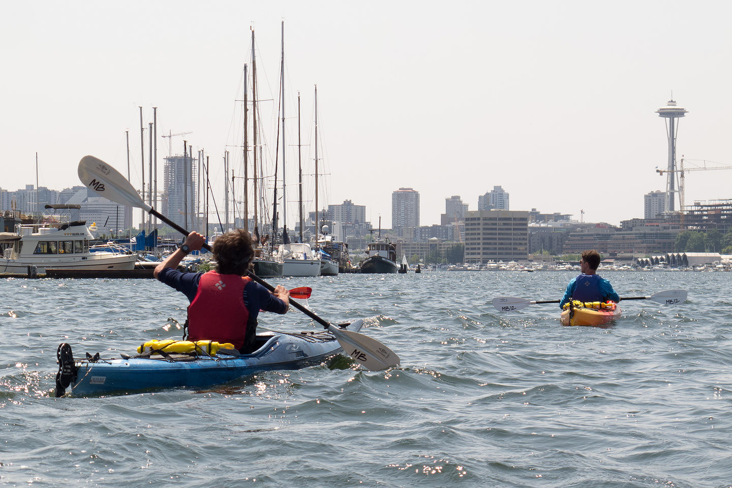 Boys Kayaking in Lake Union with Space Needle