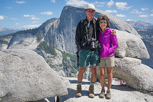 Lolo and Herb at North Dome with Half Dome and Boobs under Rock