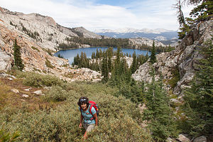 Lolo Hiking with May Lake in Background