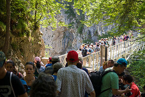 Crowds on the Marienbrucke to take the classic Neuschwanstein photo