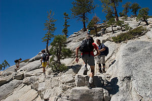 Lolo and boys hiking up Half Dome's shoulder